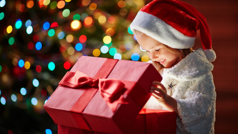 Child opening present on Christmas
